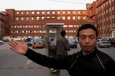 A plainclothes policeman stops the taking of photos outside the Chaoyang Hospital in Beijing where Chinese activist Chen Guangcheng was taken on May 2, 2012. Beijing pledged that the legal Chinese activist Chen Guangcheng -- who fled to the US embassy on April 22 -- and his family would...