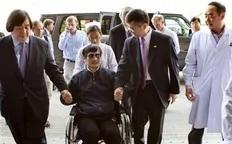 ADDS U.S. STATE DEPARTMENT LEGAL ADVISOR HAROLD KOH AT LEFT   In this photo released by the US Embassy Beijing Press Office, blind lawyer Chen Guangcheng is wheeled into a hospital by U.S. Ambassador to China Gary Locke, right, and an unidentified official at left, in Beijing Wednesday...