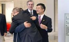 A handout photo from US Embassy Beijing Press office shows blind activist Chen Guangcheng (2nd L) hugging U.S. Assistant Secretary of State for East Asian and Pacific Affairs Kurt Campbell (front) as U.S. Ambassador to China Gary Locke (R) looks on, in Beijing, May 2, 2012.