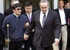 In this photo released by the US Embassy Beijing Press Office, blind lawyer Chen Guangcheng, left, is helped  by U.S. Assistant Secretary of State for East Asia and Pacific Affairs Kurt Campbell, right, and U.S. Ambassador to China Gary Locke as they leave the U.S. Embassy for a hospital...