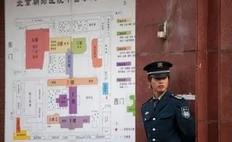 A security guard stands near a map beside a gate of the Chaoyang Hospital in Beijing where Chinese activist Chen Guangcheng was taken on May 2, 2012. Beijing pledged that the legal Chinese activist Chen Guangcheng -- who fled to the US embassy on April 22 -- and his family would be...