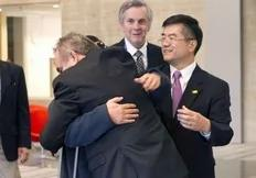 In this photo released by the US Embassy Beijing Press Office, blind lawyer Chen Guangcheng, obscured, is embraced by U.S. Assistant Secretary of State for East Asia and Pacific Affairs Kurt Campbell, as U.S. Ambassador to China Gary Locke, right, looks on, before leaving the U.S. Embassy...