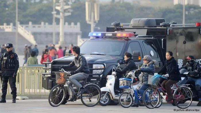 ©Kyodo/MAXPPP-30/10/2013; BEIJING, China- A police officer(L) stands guard in front of Beijing