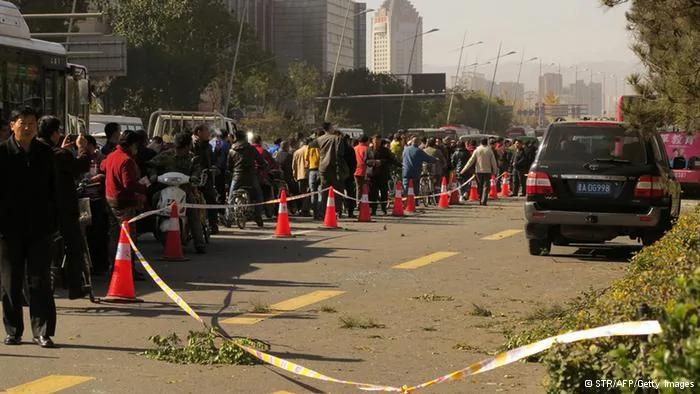 GettyImages187060123    People stand on a street after an explosion outside a provincial headquarters of China